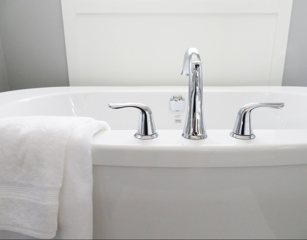 white clawfoot bathtub with silver fixtures