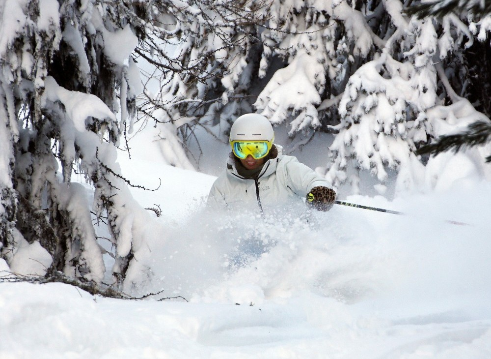 skier in powdered snow