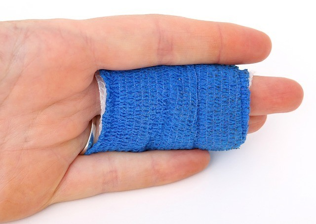 blue bandage on finger