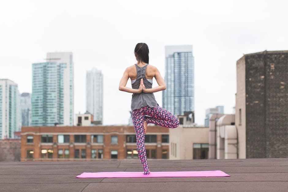 girl doing yoga on high rise