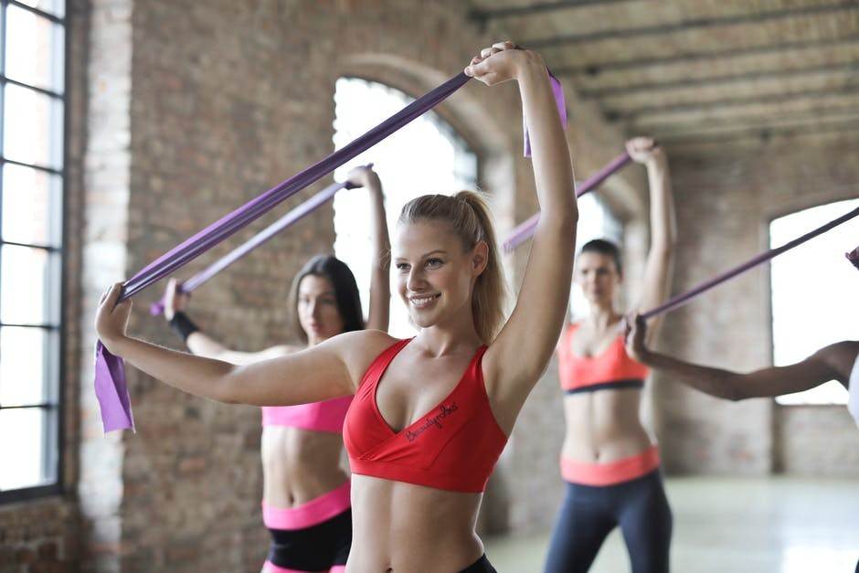 girls exercising with bands