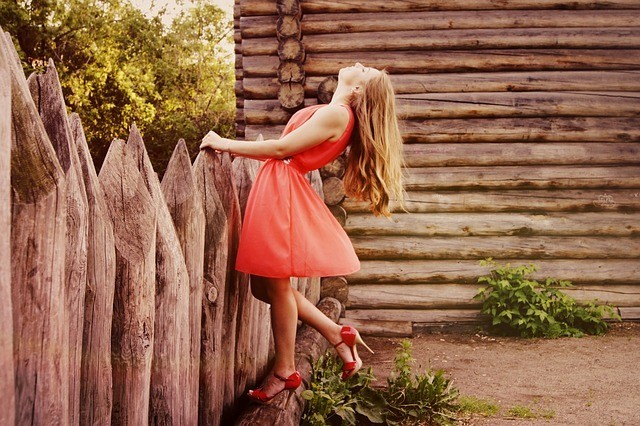 girl in orange dress by cabin