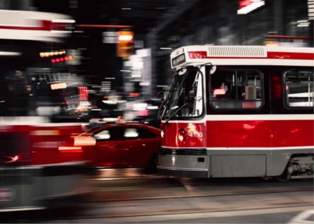 camera settings for dummies - panning technique with red bus