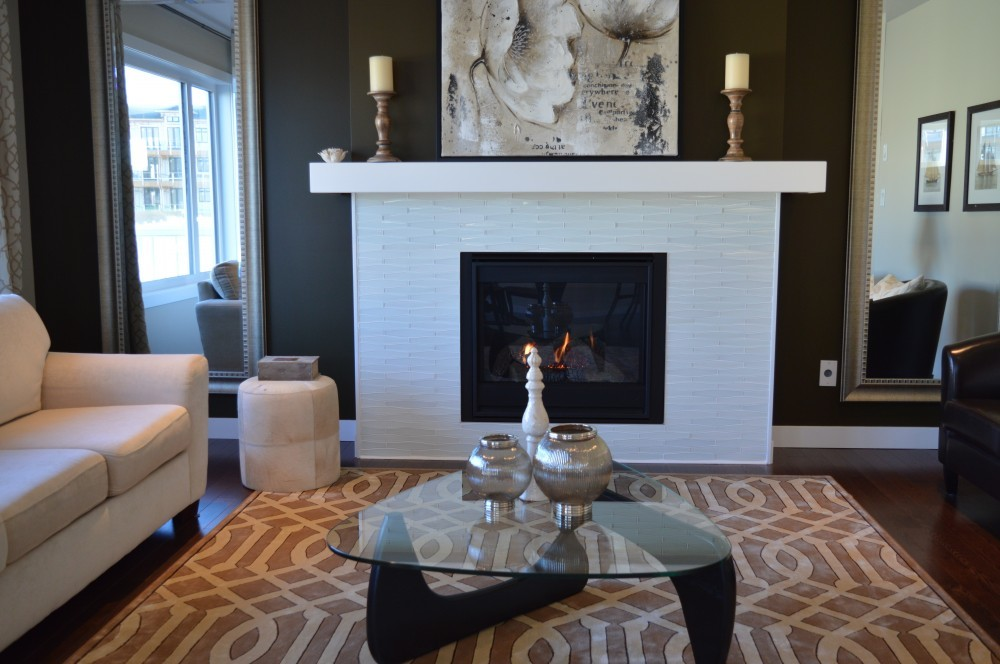 white brick fireplace with gold candelsticks
