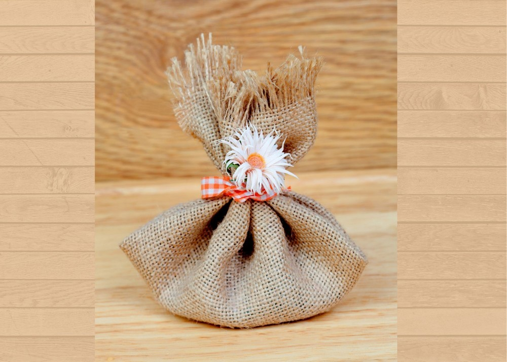 burlap package with white flower