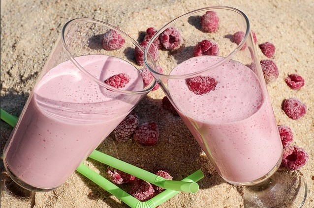 two raspberry milkshakes