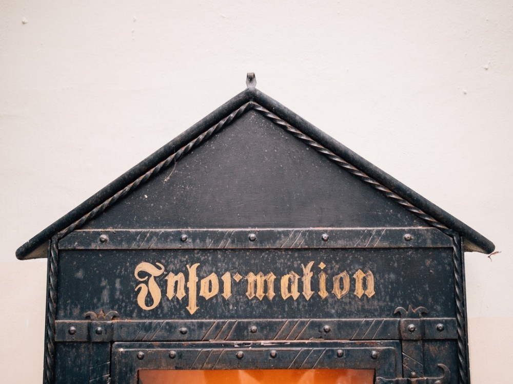 The word 'information' on house plaque