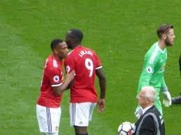 Martial and Lukaku here- congratulate each other. De Gea in the green
