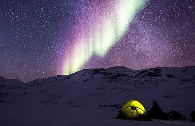 winter camping with stars and northern lights