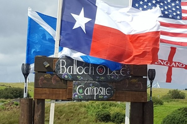 Balloch O'Dee Campsite Entrance sign and flags