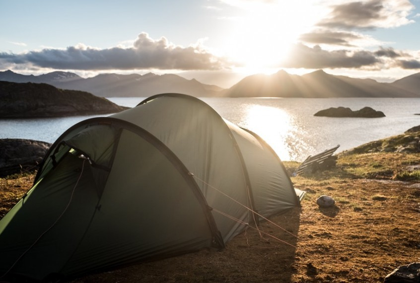 tent pitched overlooking a loch