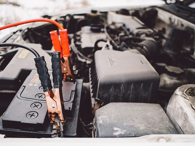 Jumper cables hooked to a car battery