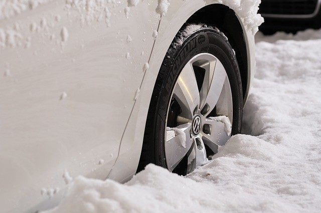 Tire snow traction devices