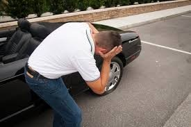 Driver with a flat tire