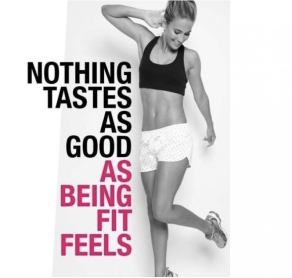 Fit woman next to motivational quote