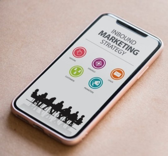 This image shows a smart phone with a marketing strategy on the screen