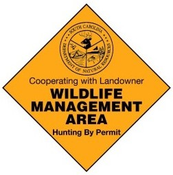 This is a picture of a wildlife management sign and a tip for deer hunting public land