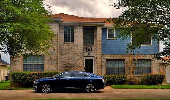 image of a house with a mortgage and a car with car payments