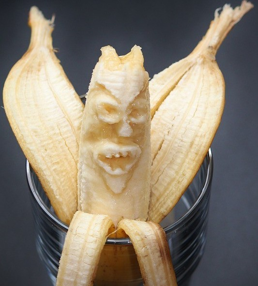 carved banana in a cup