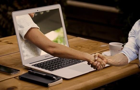 Handshake through laptop screen