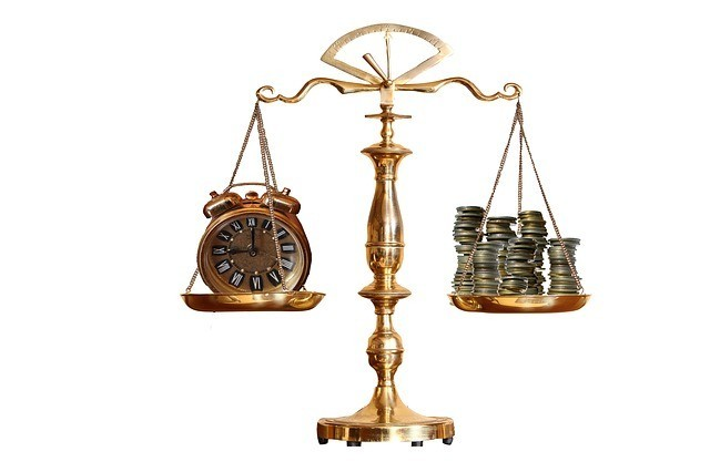 Scales showing time vs money