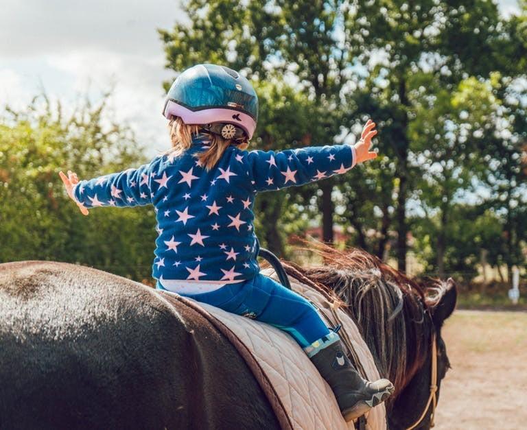 Happy child on pony