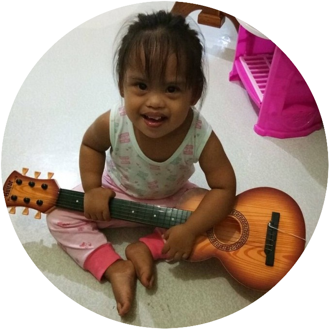 Down syndrome child plays the guitar