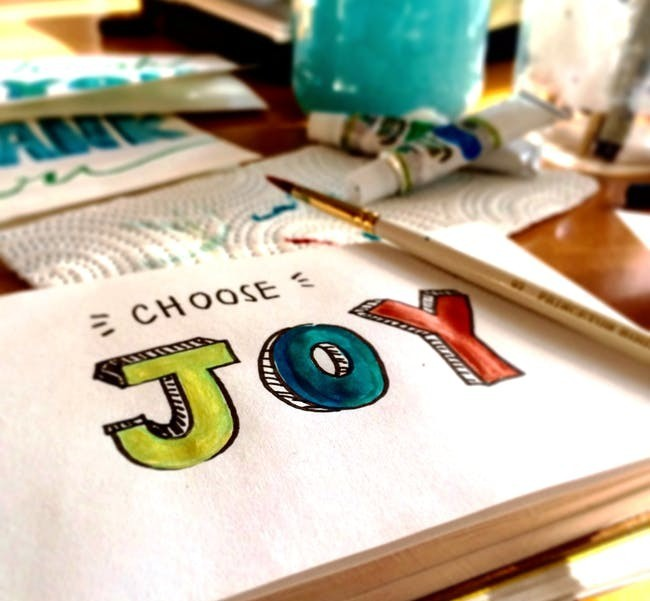 the words choose joy painted on a piece of paper