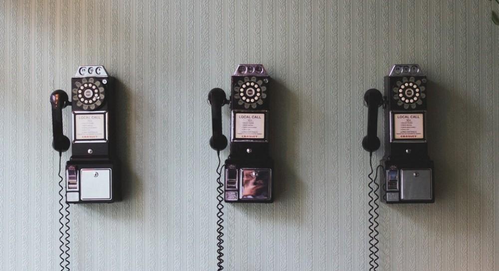 three-public-telephones