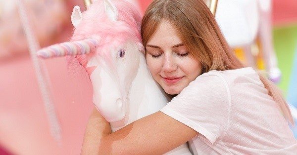 inspirational unicorn quotes woman hugging a unicorn