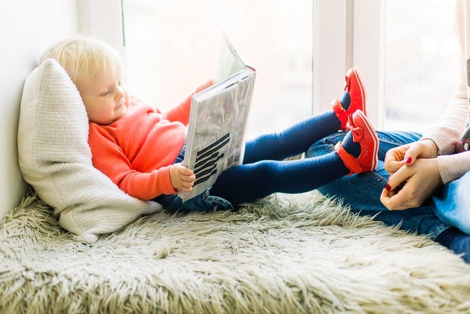 Child learning how to read