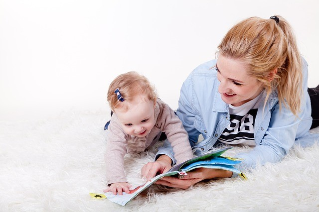 Mother teaching daughter how to read