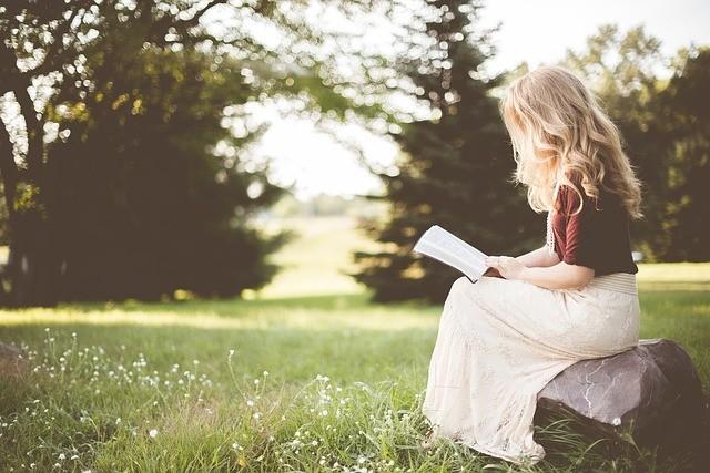 Little girl reading Christian book
