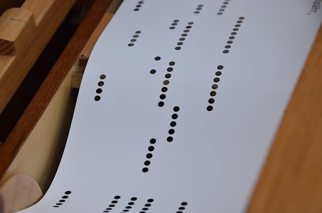 perforated paper with pre-programmed music