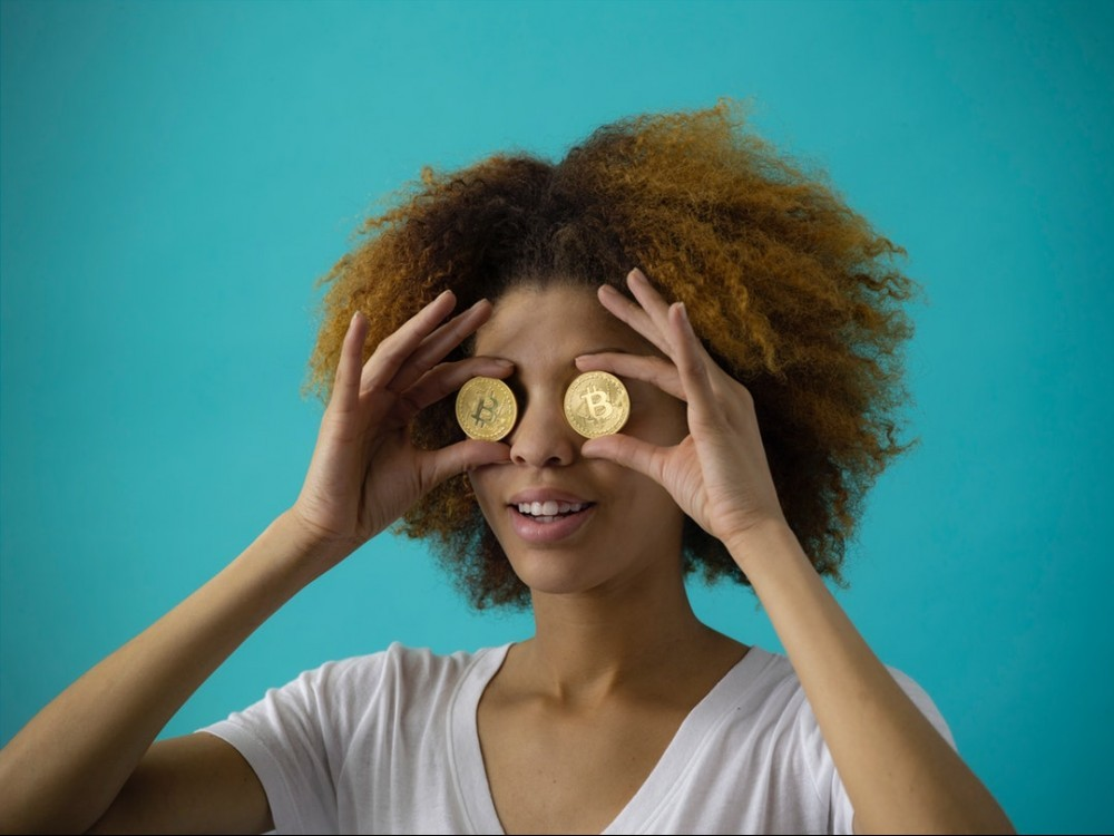 A girl with coins in front of her eyes