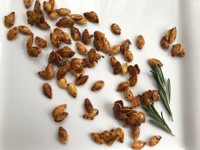 spicy maple and rosemary roasted pumpkin seeds