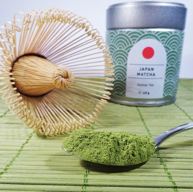 Matcha powder with whisk and container photo courtsey of teechen and pixabay