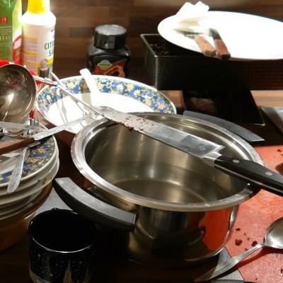 Making Your House Peaceful | Household Chore List | Dirty dishes pots and pans sit on a kitchen counter.