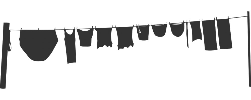 Making Your House Peaceful | Household Chore List | The black silhouette of clothes on a clothesline.