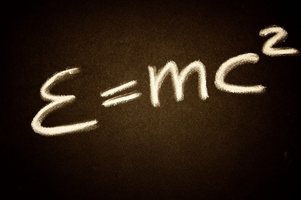 white chalk on a blackboard saying E=mc squared