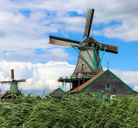 Geography Songs CD windmill green grass blue sky clouds cynthia-de-luna-459488-unsplash