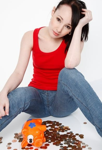 Is Affiliate Marketing Dead In 2019? Broke Woman Sitting Hopelessly on Floor With Empty Piggy Bank