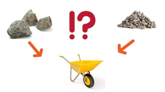 yellow wheelbarrow  with 2 heaps of stones