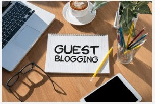Note pad with words 'Guest Blogging'on it