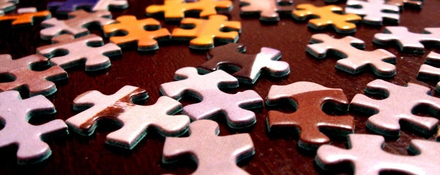 Jigsaw puzzle pieces on table