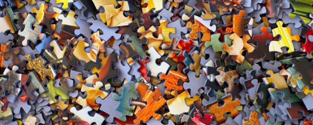 Large pile of jigsaw puzzle pieces