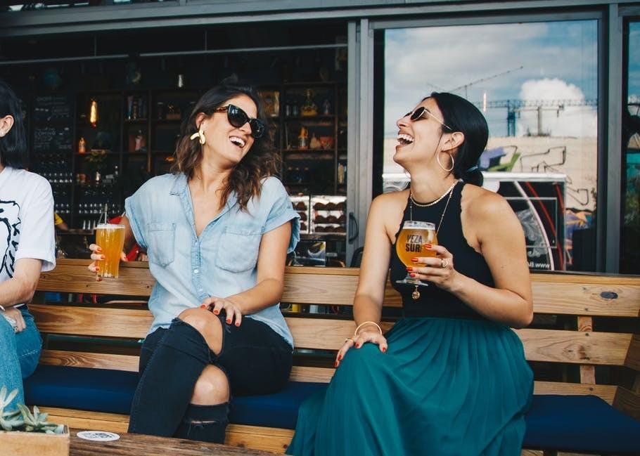 2 women enjoying a drink