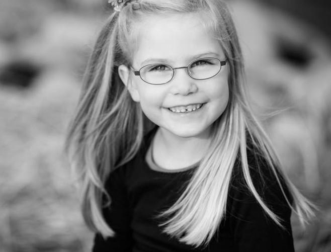 Girl with metal eyeglasses