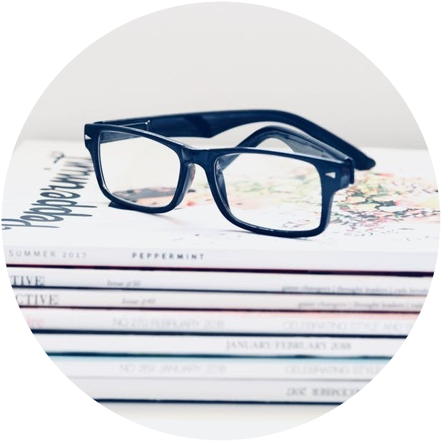 Eyeglasses on magazines