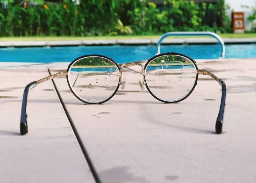 Glasses sitting by the pool